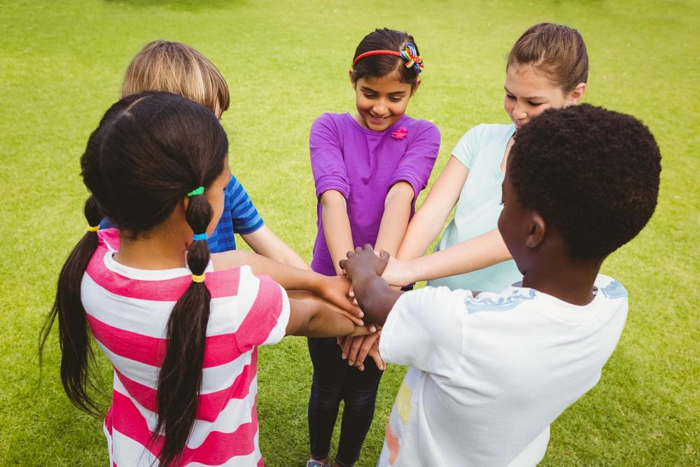 Children holding hands together at the park.jpeg