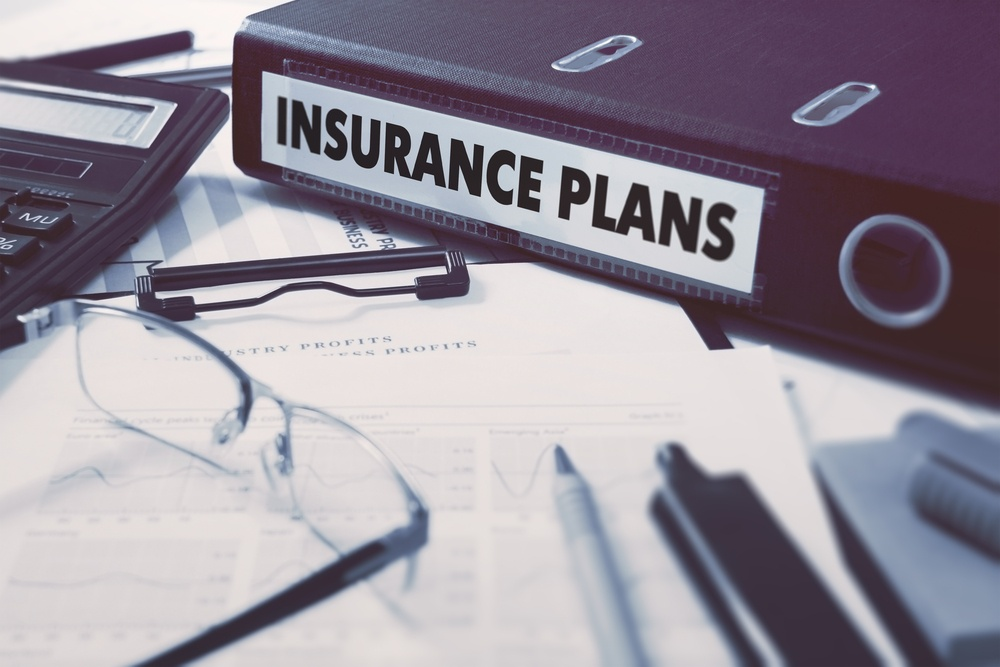 Insurance Plans - Ring Binder on Office Desktop with Office Supplies. Business Concept on Blurred Background. Toned Illustration..jpeg